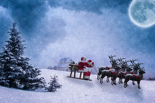 Santa and reindeer in the snow